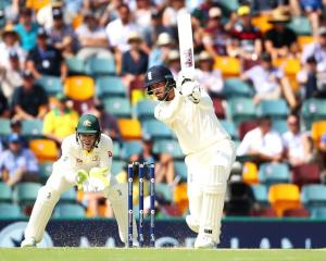 England's James Vince plays the ball through the offside on day one of the first Ashes test at...