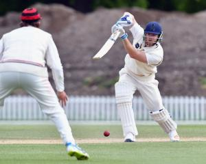 Jimmy Neesham drives the ball through the covers for Otago earlier this year. Photo: Getty Images