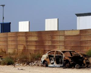 Prototypes for US President Donald Trump's border wall with Mexico are seen behind the current...