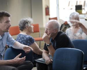 Otago Regional Council senior policy analyst Tom De Pelsemaeker (left) talks to a member of the...