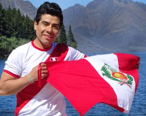 Angel Maamaai (28) shows his support for Peru in Queenstown yesterday before today's match...