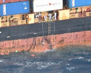 A dramatic photo released by the NZDF shows the stricken Norwegian sailor being hoisted up the...