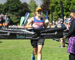 Hannah Oldroyd crosses the finish line to win the women's section of Saturday's Queenstown...