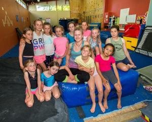 Queenstown Gymnastics Club coach Melissa Reifsteck and recreational class intermediate students...