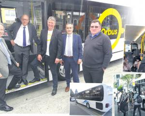 With one of Queenstown's new Ritchies-operated $2 Orbuses yesterday are (from left) NZ Transport...