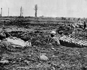 French troops shelter in shell-holes on the battlefield near Braschoote, Flanders. — Otago...