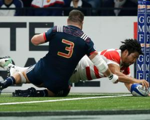 Shota Horie scores in the corner for Japan against France. Photo: Getty Images