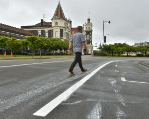Fresh road-marking paint is smeared in Anzac Ave, Dunedin. PHOTO: GREGOR RICHARDSON