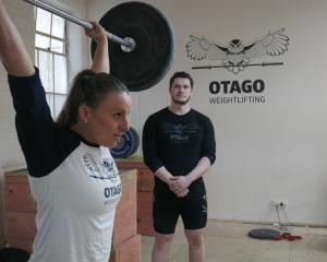 Dunedin weightlifter Amanda Gould trains at the club on Tuesday night, watched by coach Callan...