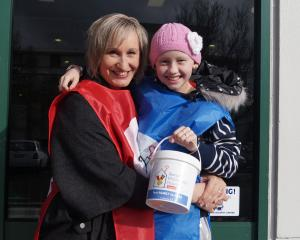 Cancer survivor Hannah Jones (10) and her mum Lea Jones  collecting for Ronald McDonald House...