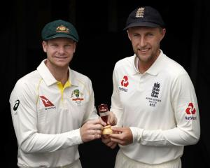 Steve Smith (left) and Joe Root with the urn prior to today's Ashes first test. Photo: Getty Images