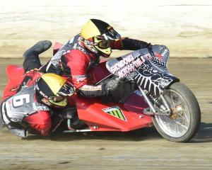 Invercargill's Erwin Tree and passenger Bret Pubben tear around the track on their sidecar outfit...