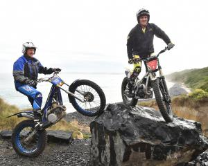 Gavin (left) and Blake Fox ride over an obstacle on their trials bikes at Blackhead yesterday...