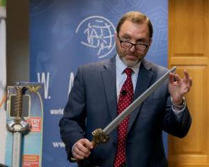 Attorney James A. Swartz holds the Wonder Woman Battle-Action Sword as he talks during the Watch...