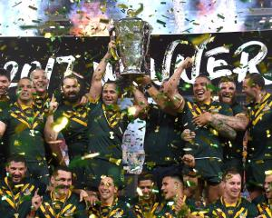 The Australian team celebrate their World Cup victory. Photo: Reuters