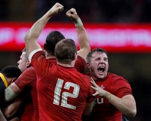 Welsh players celebrate their win over South Africa. Photo: Reuters