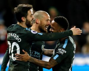 Manchester City's David Silva celebrates scoring their third goal with Raheem Sterling and...
