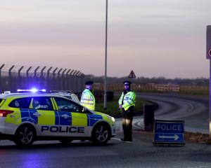 Police stand guard at the entrance to the US Air Force base at RAF Mildenhall after the incident....