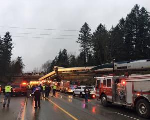 First responders at the scene of the derailment. Photo: Reuters