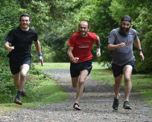 Preparing to run continuously up Mt Cargill today are (from left) Isaac Tripp, Steve Tripp and...