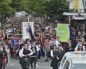 University of Otago graduands are joined by family and friends as they take over George St,...