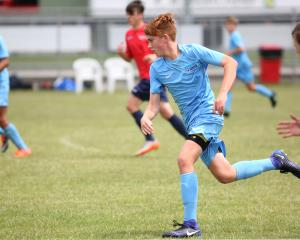 Football South under-14 player Reuben Cook  looks to move the ball forward against Waikato-Bay of...