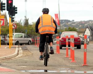 A cyclist makes their way past the redesigned intersection of Anzac Ave and State Highway 1 in...