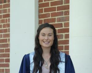 Performance analyst Anna Higgins in her Otago Polytechnic graduation gown. Photo: Supplied