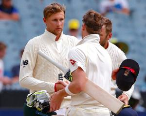 England's captain Joe Root shakes hands with Australia's captain Steve Smith to end the fourth...