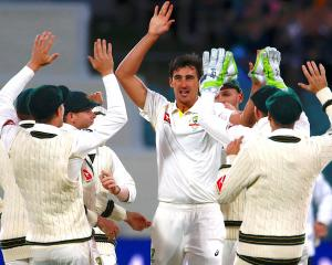 Australia's Mitchell Starc celebrates with team mates after dismissing England's Mark Stoneman...