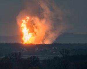 A column of fire is seen after an explosion ripped through Austria's main gas pipeline hub in...