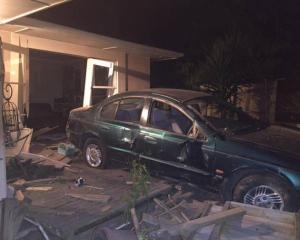 The car that crashed through the house, injuring the dog. Photo: New Zealand Police