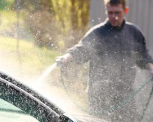 The ban in Gore applies to washing cars with a hose. Photo Getty