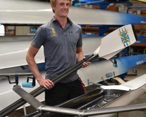 Corey Lewis (20) at the Otago University Rowing Club boat sheds on Thursday as he prepares for...
