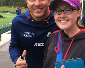 Lilly Paterson poses with Otago and New Zealand test bowling star Neil Wagner at the University...