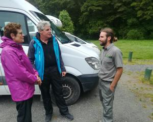 Ranger Scott Martin talks to  Dutch campers at  Purakaunui Falls  this week. Photo: Supplied