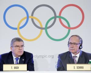 Samuel Schmid, Chair of the IOC Disciplinary Commission, and Thomas Bach, President of the...