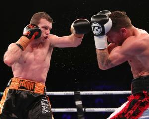 Jeff Horn throws a jab during his title defence last night. Photo: Getty Images