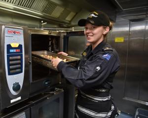 Able Chef Rianna Palmer, of Mosgiel, at work in the galley of HMNZS Otago which leaves the Birch...