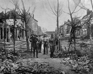 British Tommies being shown around the wrecked and shell-torn town of Nieuport, Flanders. — Otago...