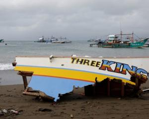 The remains of a passenger boat capsized during a typhoon last month. Photo: Reuters