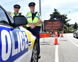 Acting Senior Sergeant Bryce Johnson (left) and Acting Otago Coastal Area Road Policing manager...
