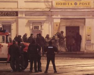 Members of a police special operations unit gather outside a post office, where a man took people...
