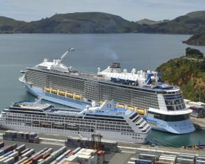 Two cruise ships, Regatta (front) and Ovation of the Seas brought thousands of visitors to...