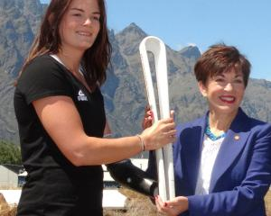 Para athlete Holly Robinson passes the Queen's Baton to Governor-General Dame Patsy Reddy at...