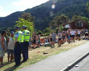 Queenstown police keep a close eye on Crate Day celebrations at Sunshine Bay on Saturday. PHOTO:...