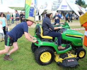 Kent Mackenzie pushes former Southland Farm Machinery group marketing co-ordinator Steph Munro as...