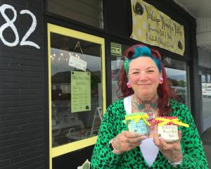 Vintage Honey's Parlour owner Nicola Chisholm displays her homemade body butters outside her shop...