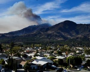 A wildfire known as the Thomas fire continues to burn in the hills outside Fillmore, California....