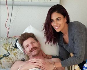 Adam Thomson pictured with partner Jessie Gurunathan in the Tsukuba Memorial Hospital in Tokyo....